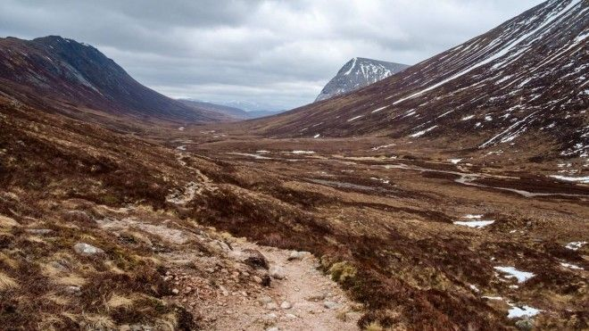 Backpack through Lairig Ghrus subarctic plateau in Scotland