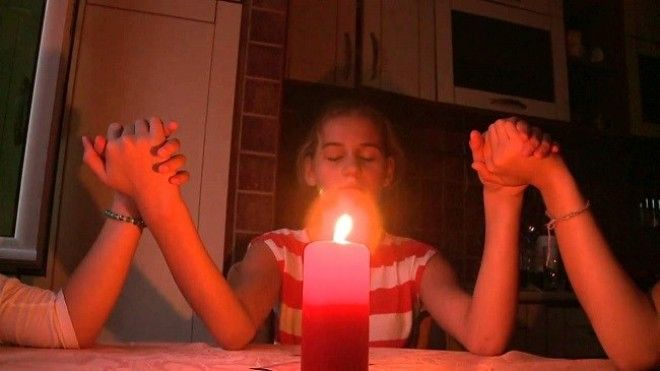 calling the ghost with candles