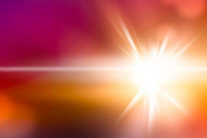 A beam of light on a pink and yellow background