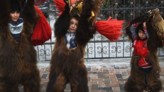 Romanian children dressed up as bears