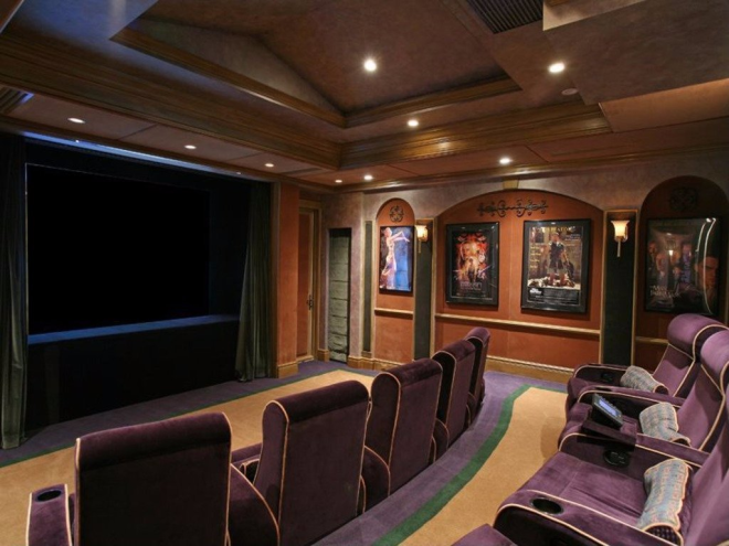 The home theater can accommodate 20 guests in plush seats.