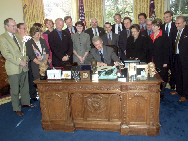 Bill Clinton's desk boasted a jumble of photos, busts, and picture frames in 2000.