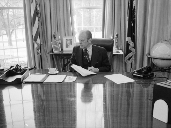 Even though this photo was taken as Gerald Ford prepared to vacate the White House, his desk still featured several stacks of papers, as well as a cup and saucer.