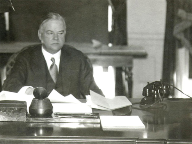 Herbert Hoover's desk was aflutter with papers in 1932.