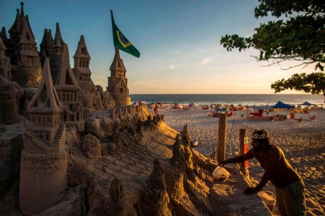 Marcio maintains his sand castle abode