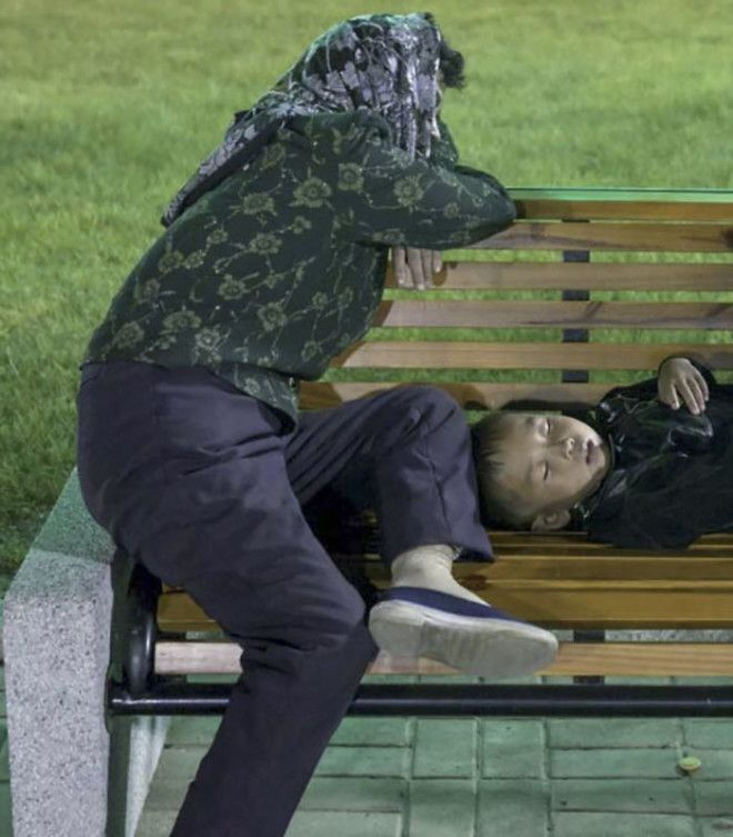 Paranoia Is Too Strong In North Korean Minds. I Took This Picture At A Fun Fair Of A Tired Mother And Child Resting On A Bench. I Was Asked To Delete The Picture Since The Guides Were Certain I Would Have Said Those People Were Homeless