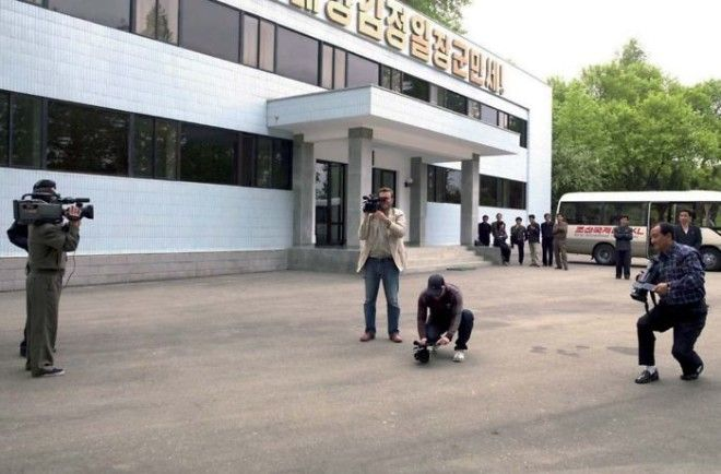 Only In North Korea: I Was At A Factory Shooting With My Tv Crew. We Were Followed By A Local Cameraman Who Filmed Throughout The Trip (On The Right). On This Day, The Government Sent Another Cameraman To Film Us All! Very Meta