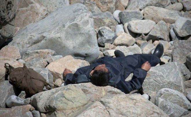 This Man Was Taking A Rest On The Rocks By The Sea In Chilbo. My Guide Asked Me To Delete This For Fear That Western Media Could Say That This Man Was Dead. He Was Alive