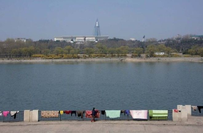On This Day In Spring, People Had Put Some Carpets To Dry On The Banks Of The Taedong River. Since There Was A Kim Il Sung Statue In The Back, Taking Picture With Those Carpets Was Forbidden