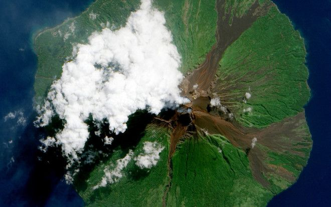 The Manam Volcano, as seen in 2010, is located a few miles off the coast of Papua New Guinea and forms a six-mile-wide island. It's hard to say what caused the white plume, but it's likely volcanic activity from this highly active crater.