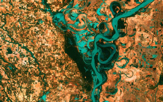 This is the Mississippi River, pictured just south of Memphis, Tennessee in 2003. You can see the blocky shapes of towns and fields surrounding the river. Countless oxbow lakes — which are formed as the river changes course — can be seen in the image as well.