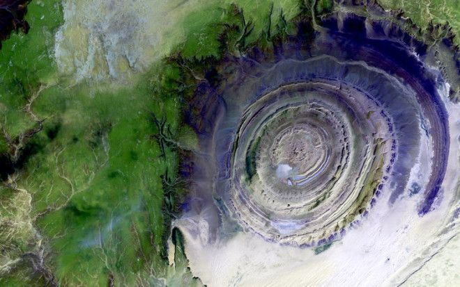 This is the otherworldly Richat Structure, a geologic formation deep in the desert in Mauritania. The formation was created when a volcanic dome hardened and gradually eroded, exposing onion-like layers of rock, according to NASA.