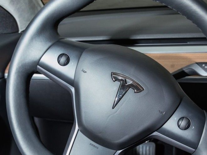 The little trackballs are controversial. This is really the only major minimalist decision in the Model 3 that's questionable.