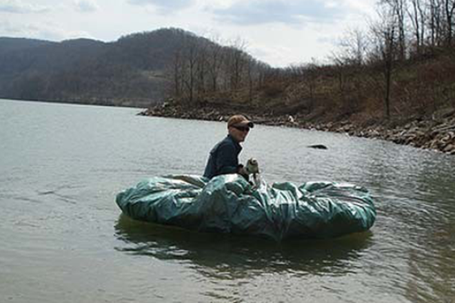 Wrapping a tarp around some logs can make a great makeshift raft.