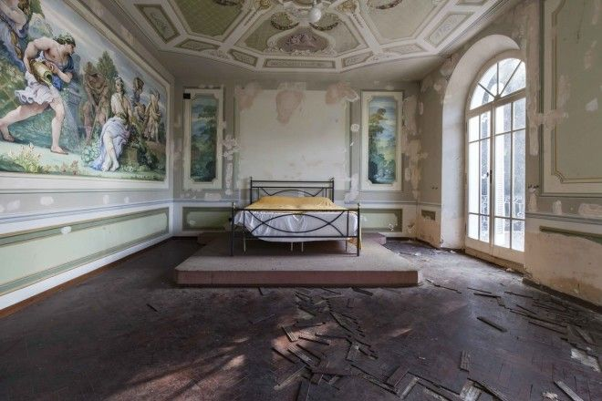 The frescoed bedroom of an abandoned villa in the Marches, central Italy.
