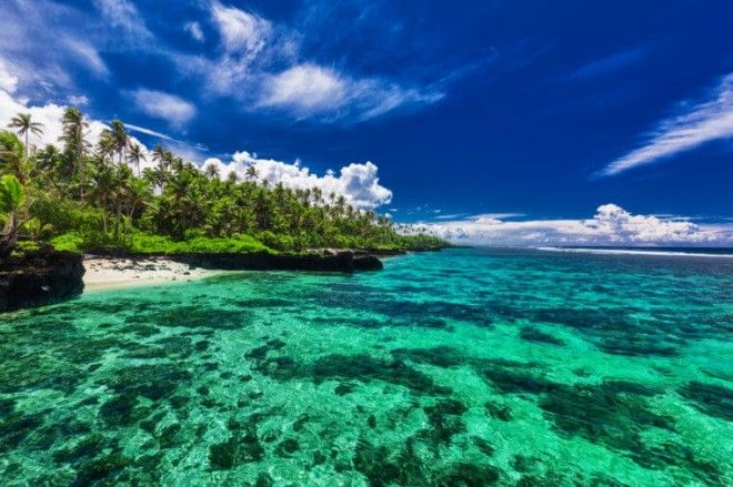 Beach with coral reef on south side of Upolu Samoa Islands