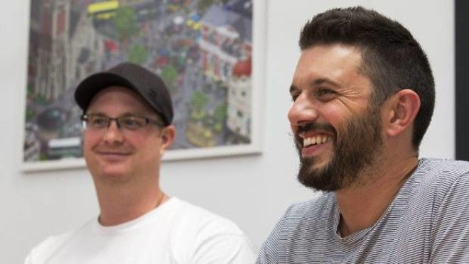 Elliot Gilmore, left and Tim Chesney, both of Make Collective. The company is offering employees $5 every time they bike ...