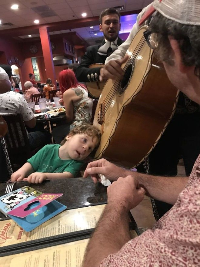 A Mariachi Musician Let My Hard Of Hearing Son Put His Head On The Guitarron So He Could Hear It He Was Amazed
