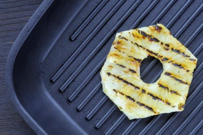 Fried pineapple on the grill Cooking fish burger