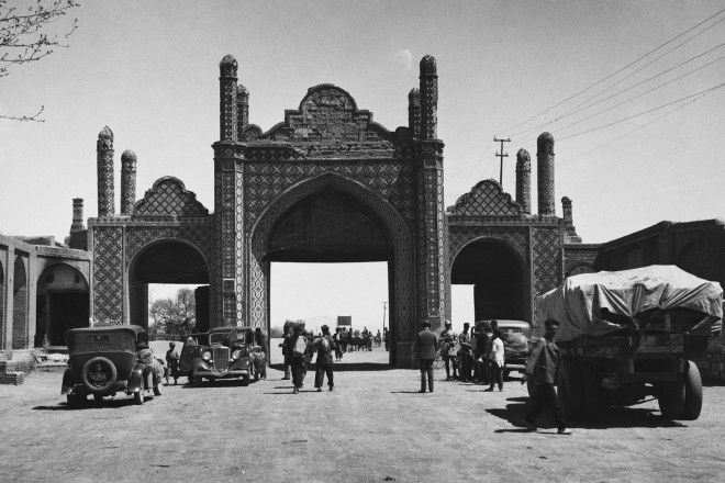 One of the last remaining gates of Tehran frame a bustling street scene.