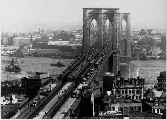 The Brooklyn Bridge is seen at the time of its completion.