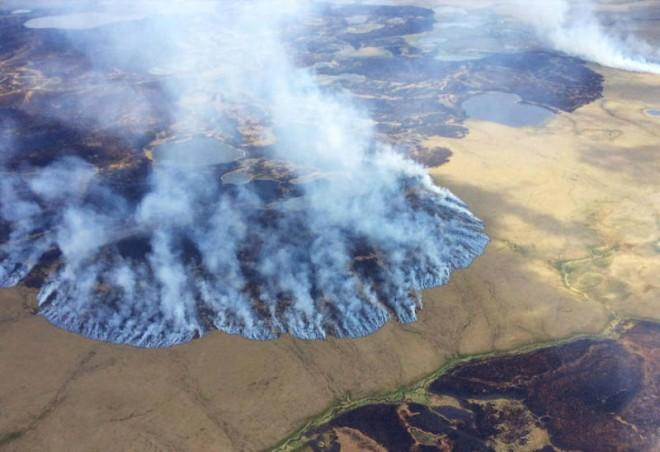 Smoke rises from the Bogus Creek Fire