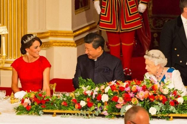 Kate stuns in red...