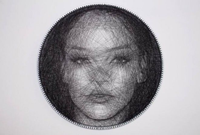 Slovenian artist Sašo Krajnc creates incredibly detailed portraits by tightly winding a single sewing thread on a circular wooden frame to create overlapping straight lines.